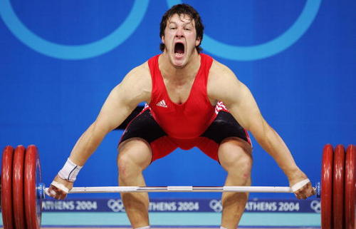 Mathias Steiner of Austria completing a lift @ Athens Olympics (photo by Robert Laberge/Getty Images)