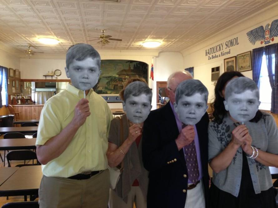 Holding up our Herman masks.
