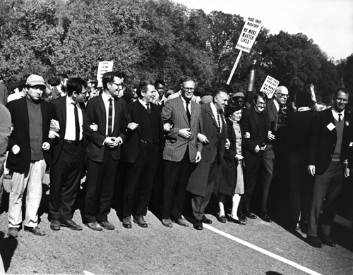 March on the Pentagon, from L-R: political activist Marcus Raskin, Chomsky, writer Norman Mailer, poet Robert Lowell, labour and anti-war activist Sidney Lens, peace protestor Dagmar Wilson, unknown, and pediatrician Benjamin Spock