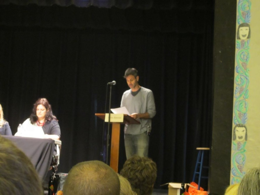 "Steve Almond reading a submission at ""Writers Idol."""