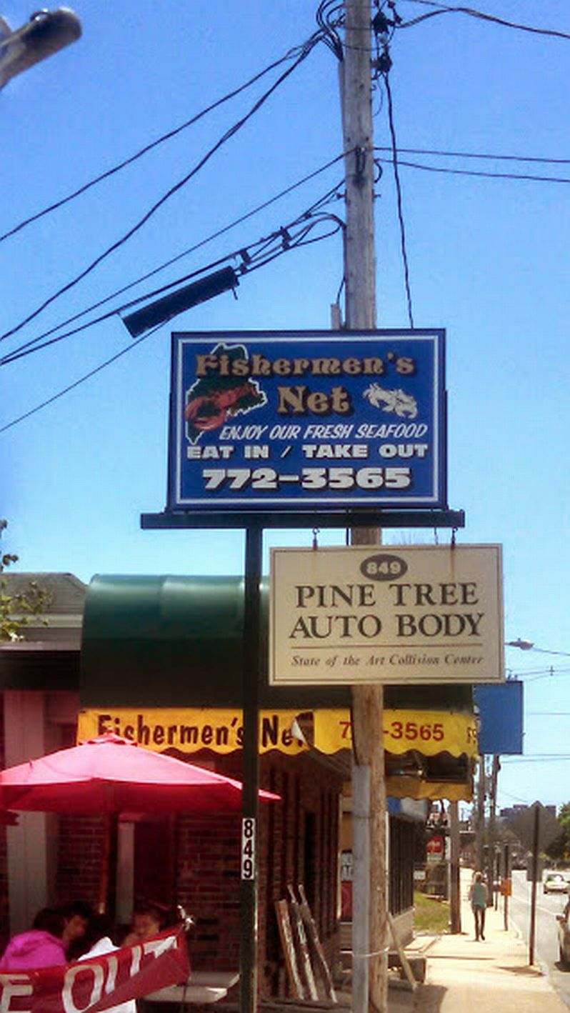 Fishermen's Net sign.