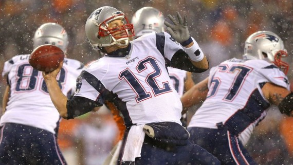Tom Brady goes downfield in the snow vs. Denver. (Justin Edmonds photo)